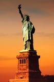 Sol på statyn av frihet Royaltyfria Bilder