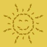 Sol sonriente de rastros en la arena Imagen de archivo libre de regalías