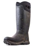 Sola bota de goma en el fondo blanco Fotografía de archivo