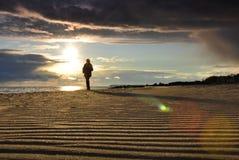 Sola muchacha en el mar Foto de archivo libre de regalías
