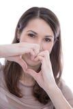 Sola mujer que hace un corazón con sus manos. Fotos de archivo libres de regalías