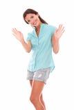 Sola señora joven que gesticula un saludo Fotografía de archivo