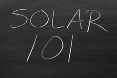 101 solaires sur un tableau noir Image stock