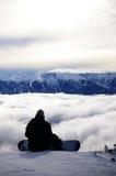 Solamente en los picos nevosos imagen de archivo libre de regalías