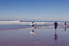 Solana beach surfers in the morning Stock Images