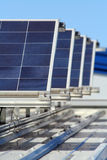 Solar. Rows with sunny sky on a rooftop Stock Photography