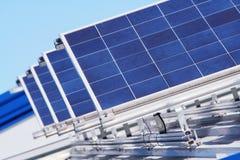 Solar. Rows with sunny sky on a rooftop Stock Photos