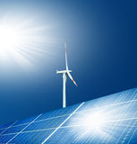 Solar. Energy panels and a windmill with blue sky Royalty Free Stock Image