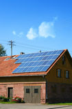 Solar. House with solar panels on the roof royalty free stock image