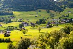 Solar alpine village in Switzerland. Alpine village in a green valley in Switzerland Stock Photography