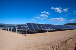 Solar array. Large photovoltaic system at the UNM-Taos Klauer Campus, NM Royalty Free Stock Images
