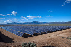 Solar array. Large photovoltaic system at the UNM-Taos Klauer Campus, NM Stock Images