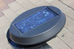 Solar Attic Fan. A close up view of a solar attic fan installed on a roof top Royalty Free Stock Photography