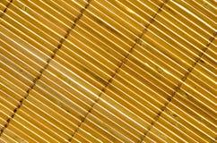 The bamboo curtain. Blinds bamboo illuminated by the sun Stock Photos