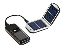 Solar battery. Charges your mobile phone from the solar Stock Photos