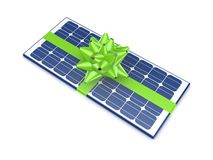 Solar battery decorated with a green ribbon. Royalty Free Stock Images