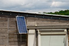 Solar battery on the house. Solar battery installed on a residential house Stock Photography