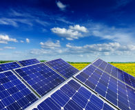 Solar battery panels in rural meadow field Royalty Free Stock Photography