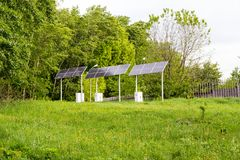 Solar battery powers an electric lamp in the park. Solar array in the park for track lighting Stock Photos