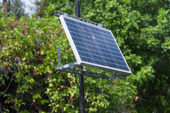 Solar battery powers an electric lamp in the park Stock Photography