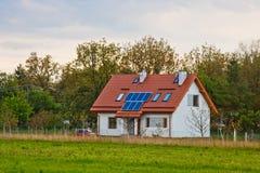 Solar battery on the roof of a rural house under a blue sunny sky. solar energy, alternative electricity stock photo