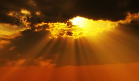 Solar beams. Magic solar beams coming out across clouds Stock Image