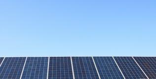 Solar big panels over blue sky Royalty Free Stock Photo