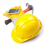 Solar - calculadora de los guantes del martillo del sombrero duro foto de archivo