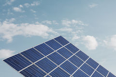 Solar cell against smooth cloudy sky Stock Images
