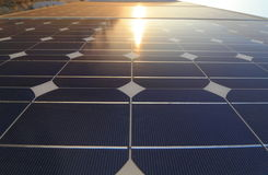 Solar cell battery with sunset Stock Photos