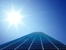 Solar cell energy grid in sun and sky background Royalty Free Stock Images
