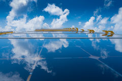 Solar cell Energy, white cloud and blue sky reflect on solar cell panel at offshore oil and gas field. Royalty Free Stock Image