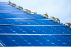 Solar Cell Generated Electrical Power by Sun Light, Closeup of Blue Photovoltaic Solar Panels, Green Energy for Safe World Stock Photo