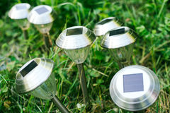 Solar cell panel on lanterns. For the garden on a green glade Royalty Free Stock Photo