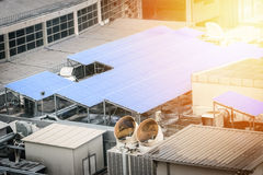 Solar cell panel on the rooftop. Of office or factory building with sunlight effect filter. Solar energy concept stock photo