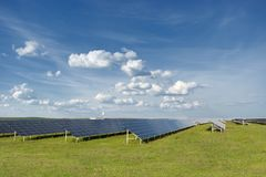 Solar cell panels in a photovoltaic power plant. Renewable energy - alternative electricity source Stock Image