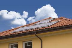 Solar cell on the roof. With blue sky Stock Photos