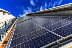 Solar cell on roof top against blue sunny sky. Alternative energy Royalty Free Stock Images