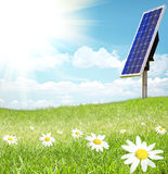 Solar cell and sunray. Green Landscape with solar cell and sunray stock photo