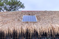 Solar cell on thatched roof for energy in forest Royalty Free Stock Photography