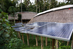 Solar cell tree in green village. Bali indonesia Stock Photo