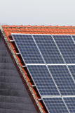 Solar cells. Panels of solar cells on a roof Royalty Free Stock Images