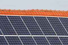 Solar cells. Panels of solar cells on a roof Stock Images