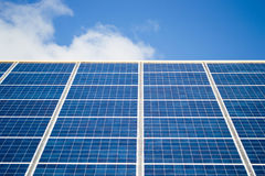 Solar cells. With blue sky and clouds in background Royalty Free Stock Images