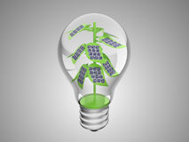 Solar cells on green plant inside lightbulb Stock Photos