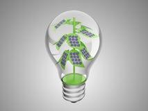 Solar cells on green plant inside lightbulb Stock Photos