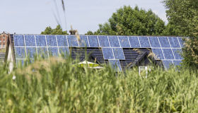 Solar cells on house roof royalty free stock image