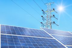 Free Solar Cells In Power Station Alternative Energy From The Sun With High Voltage Electric Pylon Pillars Stock Image - 129880991