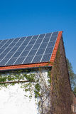 Solar cells on an old house Royalty Free Stock Images