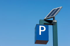 Solar cells in operation. Solar cells generating electricity for a parking meter against a blue sky Royalty Free Stock Photos